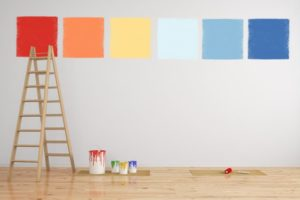 six different paint color samples painted on a wall